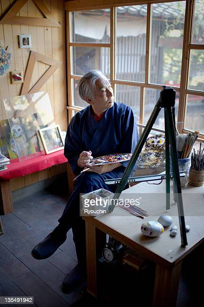 painter who draws a picture in an atelier