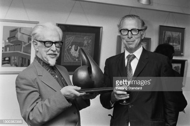 Painter Wilfred Sirrell with newspaper editor Charles Wintour at an art exhibition, UK, 24th May 1972.