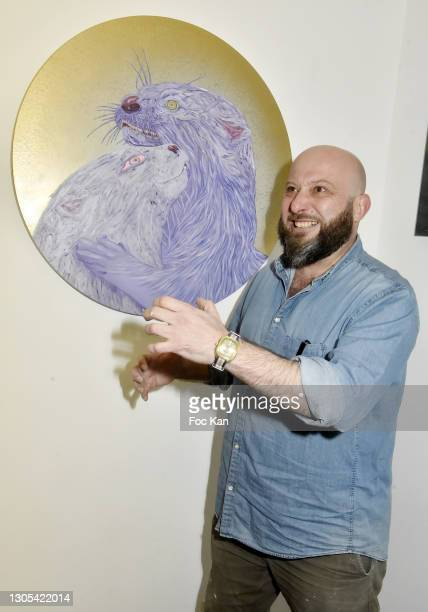 """Painter/curator Marc Molk poses with his work during """"Ils Ont Dit Oui"""" Exhibition an Amalteo Institute Project Curated by Marc Molk at Galerie..."""