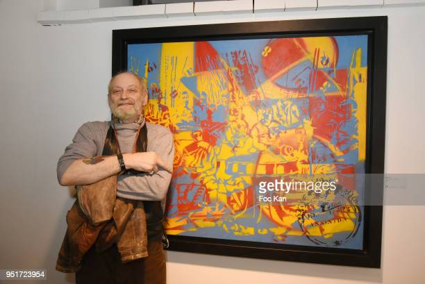 Painter/guitarist Epsylon Point poses with his work during Mai 68 Painting Collective Exhibition at Brugier Rigail Galerie on April 26 2018 in Paris...