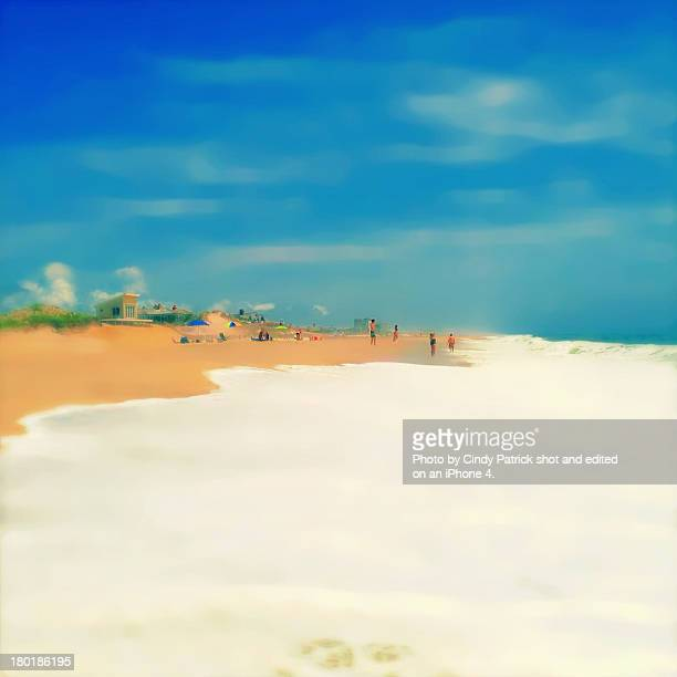 A painterly image of people on a beach