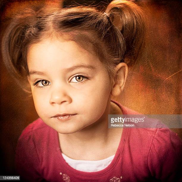 painterly portrait of little girl in pig tails - rebecca nelson stock pictures, royalty-free photos & images
