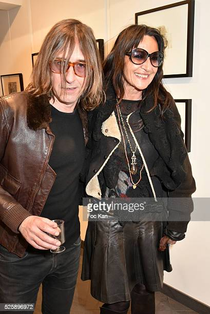 Painter/musician/singer Pierre Emery from Ultra Orange band and Agnes M Laterre attend the 'As Hard' Pierre Emery Paintings /Collages Exhibition at...