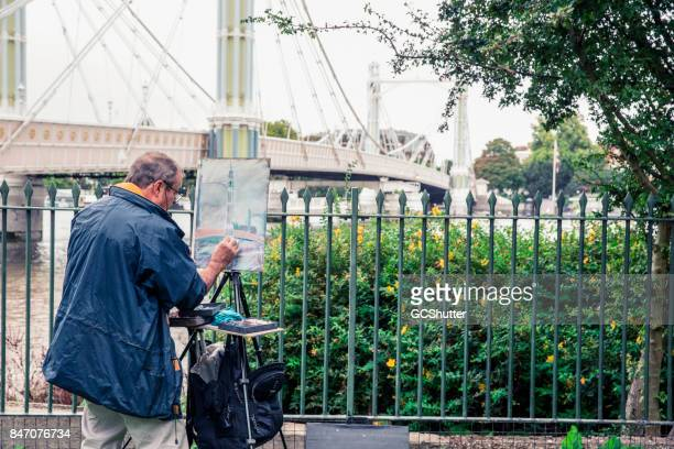 painters at work by the bridge near battersea park - battersea park stock photos and pictures
