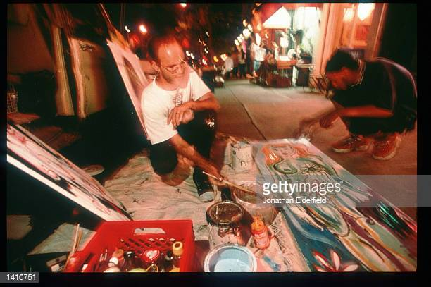 Painters BTubbs and Enrico Thomas create work in the East Village June 1 1998 in New York City Populated by residents of numerous heritages including...