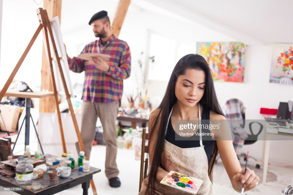 Painters drawing in studio : Stock Photo