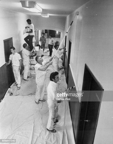 Painters give a Helping Hand Members of local 79 of the Painters and Dry Wall Finishers Union paint the interior of the Hope Center for Retarded...