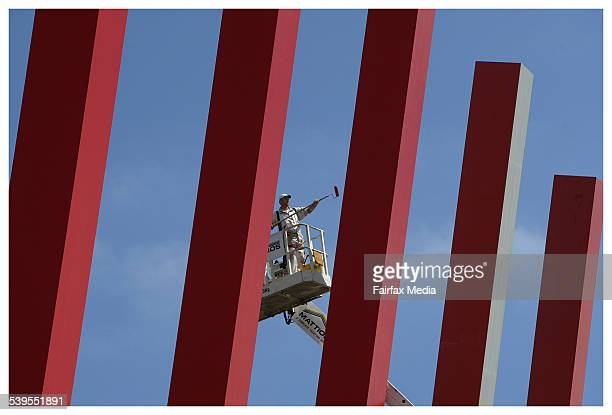 Painters give the red zipper a spruce up on City Link 22nd February 2005 AGE BUSINESS Picture by CRAIG ABRAHAM