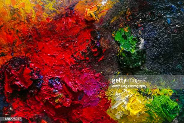 a painter's messy palette - artist's palette stock photos and pictures