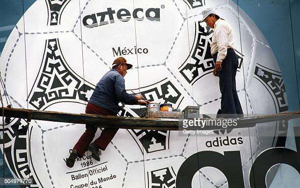 Painters paint a mural of the official Adidas Tango ball for the Mexico 1986 FIFA World Cup in Mexico 1986