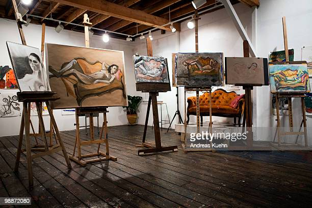 painters studio with art work on easels. - staffelei stock-fotos und bilder