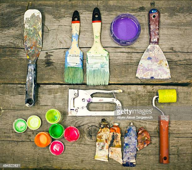 painter's supplies on wooden table - art and craft equipment stock pictures, royalty-free photos & images