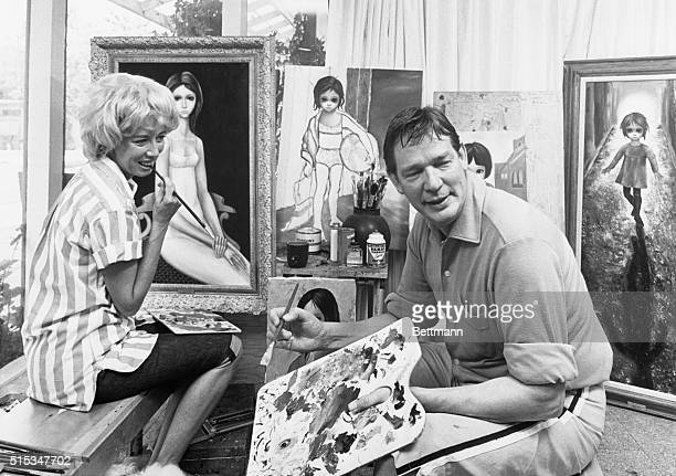 Painters Walter and Margaret Keane get busy with their palettes in the 'Paint Room' of their home here In background are some of the paintings of...