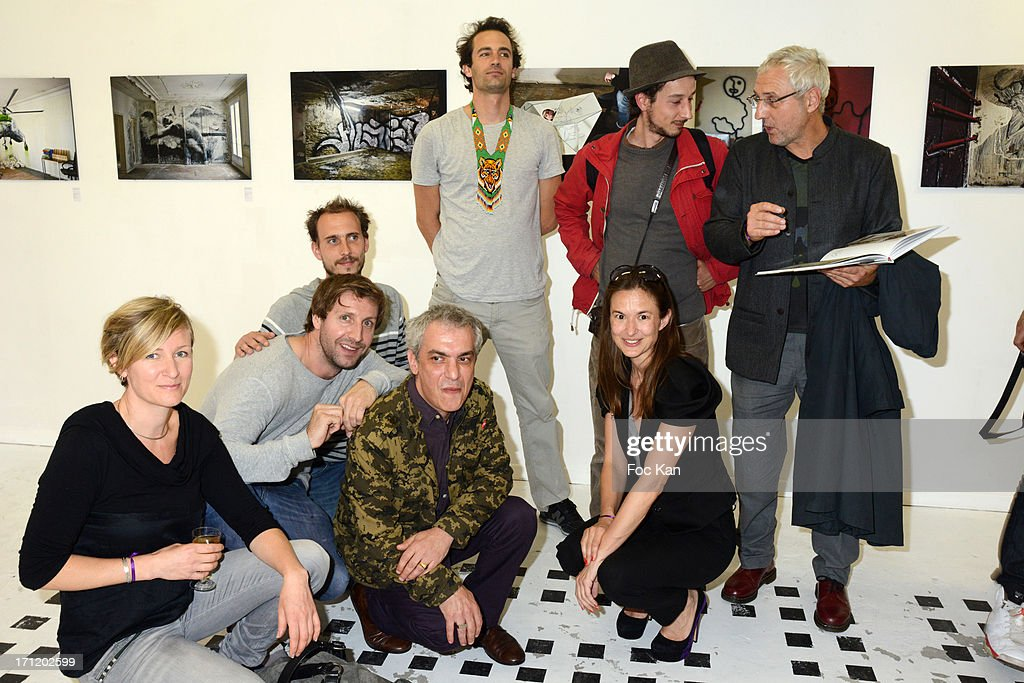 Painters Yz, Nasty, Gilbert 1, Alex Psyckoze, L'Atlas, Parole, curator Magda Danysz and Mosko attend 'Les Bains Residence d'Artistes' Exhibition Preview And Book Launch at the Galerie Magda Danysz on June 22, 2013 in Paris, France.