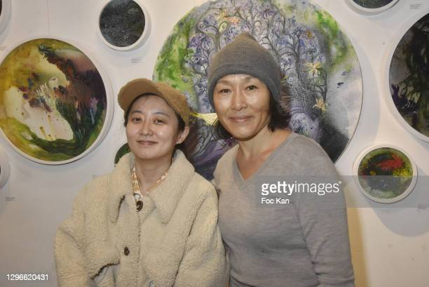 """Painters Zhu Wenyu and Xiuyi Shen attend """"Voyages Au Pluriel"""" Preview at 24 Rue De Lappe on January 15, 2021 in Paris, France."""