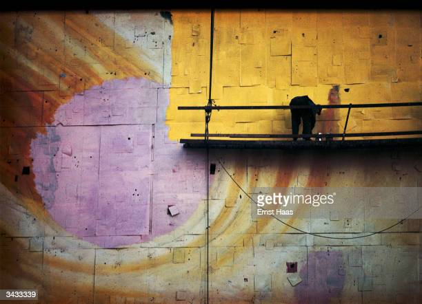 Painting a billboard on Broadway from a cradle Colour photography book