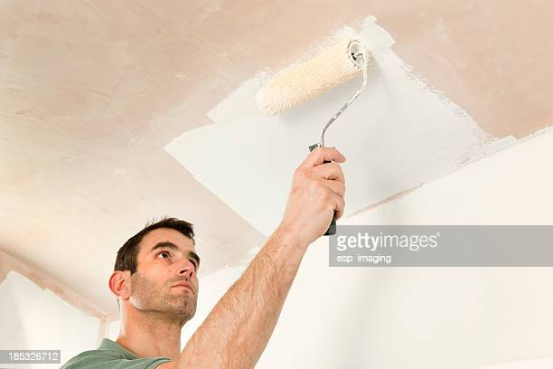 painting a ceiling by roller - ceiling stock pictures, royalty-free photos & images