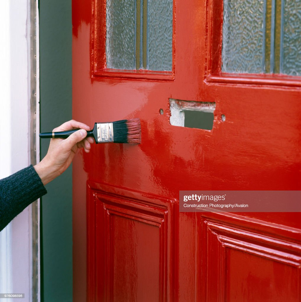 Painting A Front Door With Bright Red