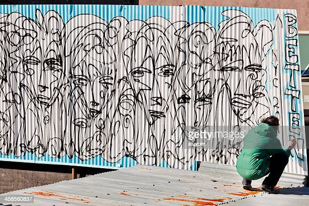 painting a graffiti in new york city - street artist stock pictures, royalty-free photos & images
