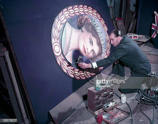 Painting a roundel of Queen Elizabeth II in preparation for her Coronation circa June 1953