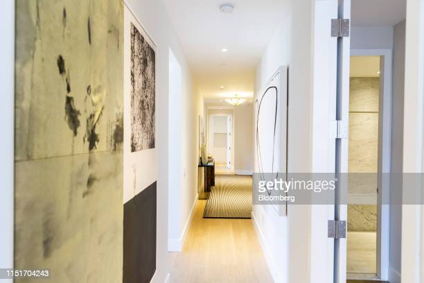 Painting are displayed in the hallway of an apartment unit in the AvalonBay Communities Inc Park Loggia condominium at 15 West 61 Street in New York...