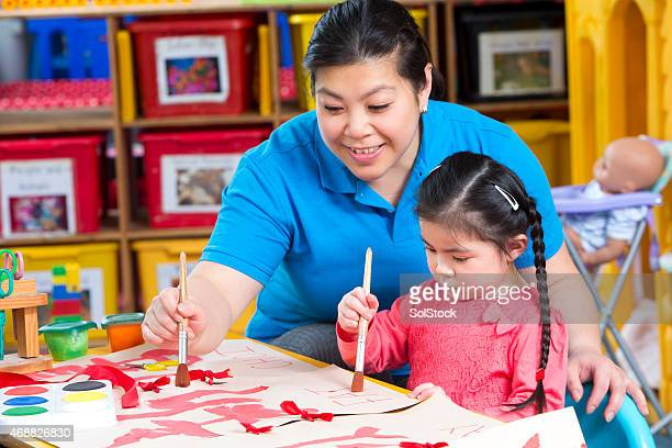 painting at nursery - non western script stock pictures, royalty-free photos & images