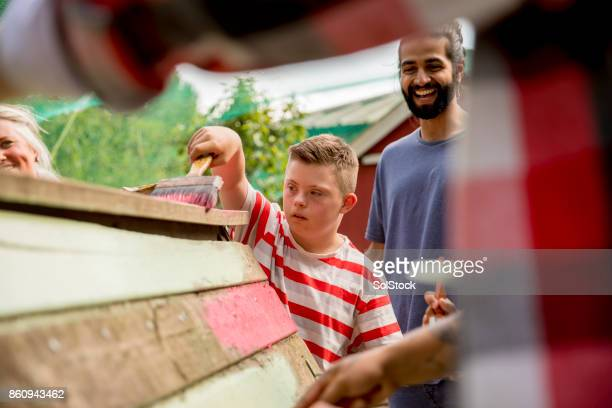 painting at the farm - down syndrome stock pictures, royalty-free photos & images