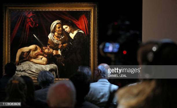 TOPSHOT A painting believed to be the second version of Judith Beheading Holofernes by Italian artist Michelangelo Merisi da Caravaggio is picutred...