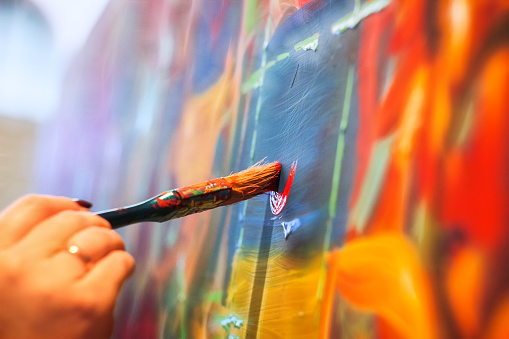 painting brush on wall 891352134