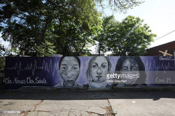 """A painting by the graffiti artist Bandit titled """"Our Nurses Our Saints"""" is seen on a wall in the lower ninth ward on April 03 2020 in New Orleans..."""