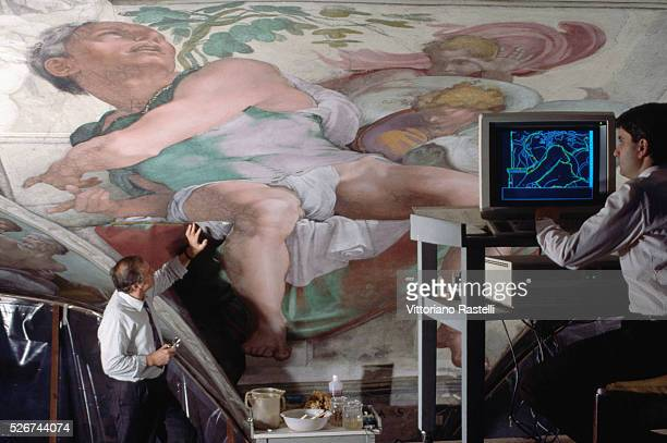 Painting conservators use computer technology in the restoration of Michelangelo's frescoes in the Sistine Chapel