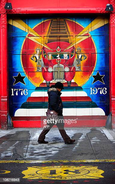 A painting decorates the entrance of a fire station in downtown Manhattan in New York January 14 2010 AFP PHOTO/Emmanuel Dunand