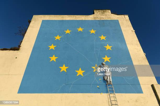 A painting depicting a workman chipping away at a star on the EU flag by artist Banksy is seen on January 03 2019 in Dover England The port town of...