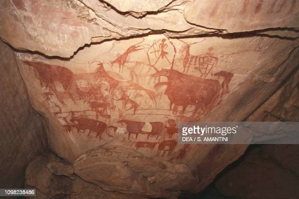 Painting depicting hunting scenes, Saharan rock art, Enneri Tougwi, Tibesti, Chad.