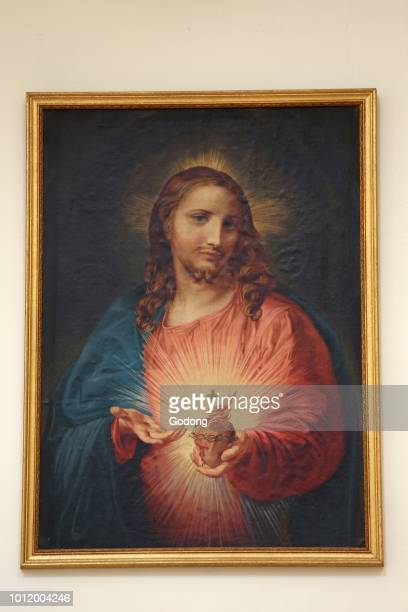 Painting depicting Jesus showing his sacred heart in Madona del Carmine church Nardo Italy