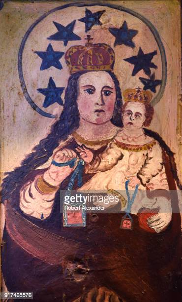 A painting depicting Nuestra Senora del Carmen is among the images of saints on a circa 1850 wood altar screen for sale in a Santa Fe New Mexico shop