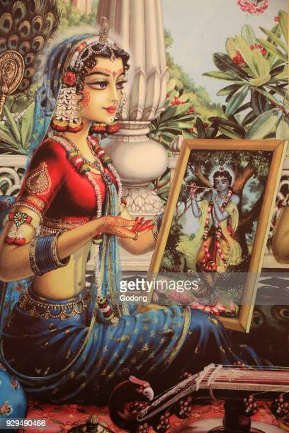 Painting depicting Radha looking at a picture of Krishna India
