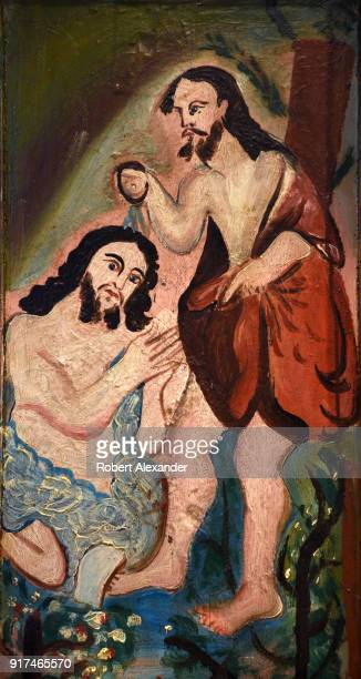A painting depicting San Juan baptizing Jesus is among the images of saints on a circa 1850 wood altar screen for sale in a Santa Fe New Mexico shop