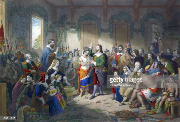 Painting depicting the marriage ceremony of British colonist John Rolfe to Native American Pocahontas the daughter of Chief Powhatan of the...