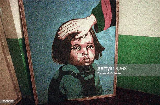 A painting depicts a crying child at the Tahia Maskan Orphanage May 18 2003 in Kabul Afghanistan Two state run orphanages help deal with the...