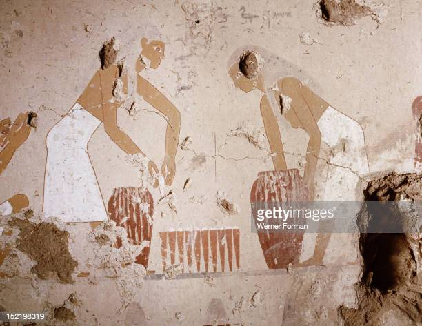 A painting detail in the tomb of Senet showing bread making Moulds are filled with dough taken from large jars and then stacked for baking Bread...