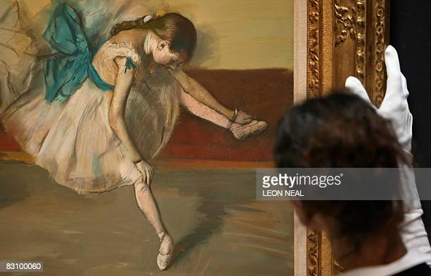 A painting entitled Danseuse au repos by French artist Edgar Degas is displayed at the Sotheby's auction house in London on October 3 2008 The...