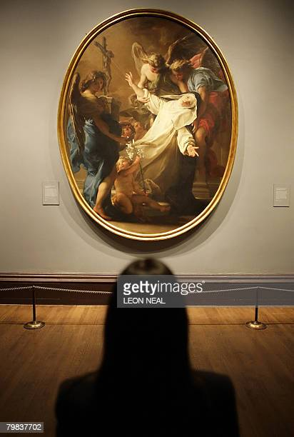 A painting entitled 'The Ecstasy of Saint Catherine of Siena' by Italian artist Pompeo Batoni is pictured at the National Gallery in London on...