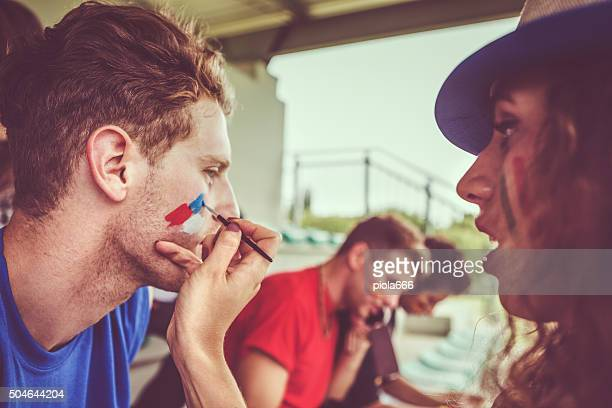 Painting face to sport supporter