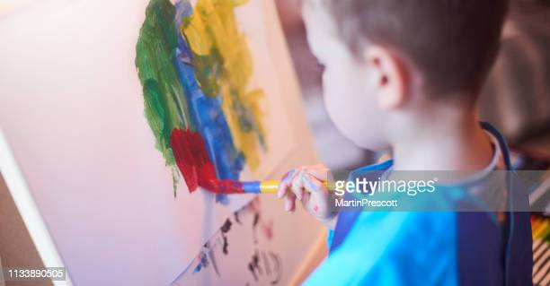 painting fun - easel stock pictures, royalty-free photos & images
