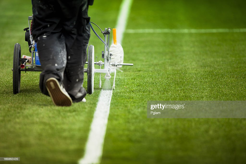 Painting grass turf lines on a sports field : Stock Photo