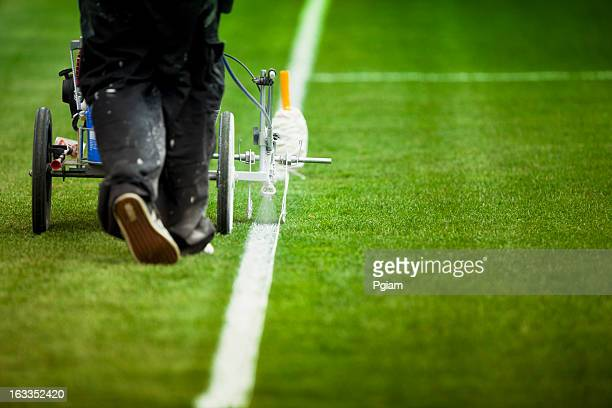 Painting grass turf lines on a sports field