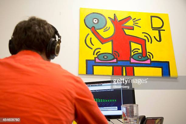 A painting hangs above DJ Bruggemann manager of business development at Social Tables Inc while working at his desk at the Social Tables headquarters...