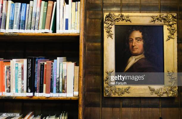 A painting hangs alongside shelves of books inside the Leeds Library on January 9 2018 in Leeds England This year sees the 250th anniversary of the...
