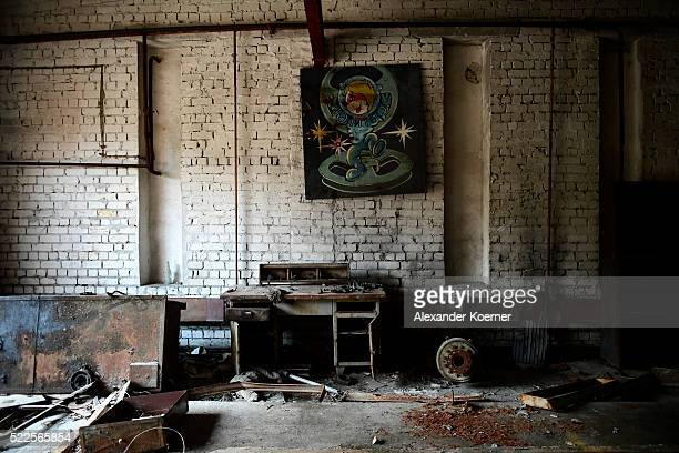 A painting hangs inside an abandoned house while on set during the shooting for the new local production 'Wigald Fritz Die Geschichtsjaeger' by the...